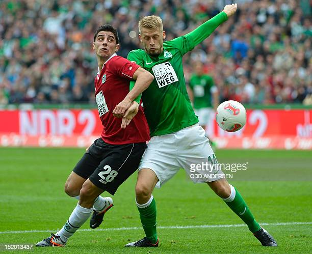 Bremen's midfielder Aaron Hunt and Hanover's midfielder Lars Stindl vie for the ball during the German first division Bundesliga football match...