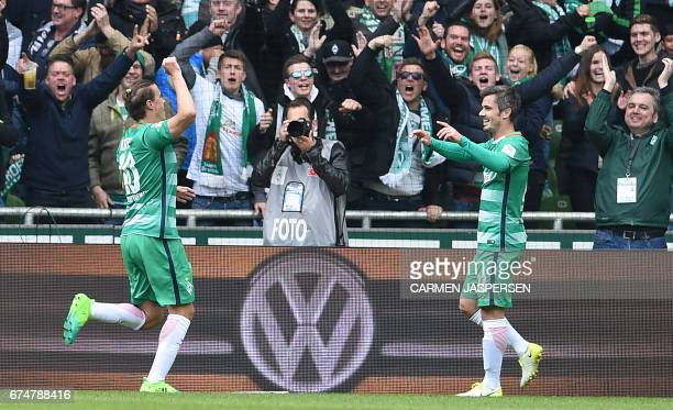 Bremen's midfielder Fin Bartels and Bremen's forward Max Kruse celebrate the 2:0 during the German first division Bundesliga football match between...