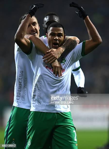 Bremen's midfielder Max Kruse and Bremen's midfielder Serge Gnabry celebrate during the German first division Bundesliga football match Werder Bremen...