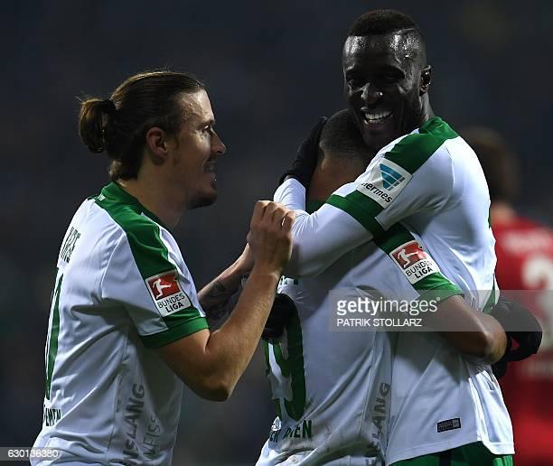 Bremen's midfielder Serge Gnabry Bremen's midfielder Max Kruse and Bremen's defender Lamine Sané celebrate during the German first division...