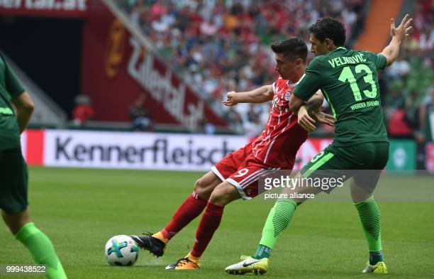 Bremen's Milos Veljkovic and Bayern's Robert Lewandowski in action during the Bundesliga soccer match between Werder Bremen and Bayern Munich at the...