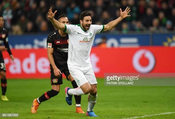 Bremen's Peruvian striker Claudio Pizarro celebrates scoring during the German First division Bundesliga football match Bayer Leverkusen vs Werder...