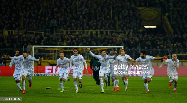 Bremen's Player celebrates after the German Cup last 16 football match BVB Borussia Dortmund v Werder Bremen in Dortmund western Germany on February...
