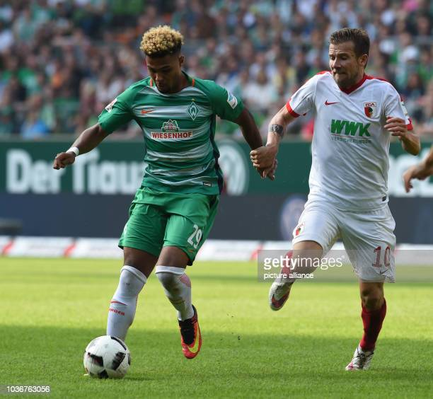 Bremen's Serge Gnabry and Augsburg's Daniel Baier in action during the Bundesliga soccer match between Werder Bremen and FC Augsburg at Weserstadion...