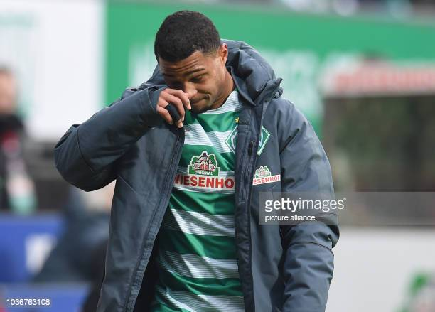 Bremen's Serge Gnabry leaves the field with an injury during the German Bundesliga soccer match between Werder Bremen and Borussia Dortmund in the...