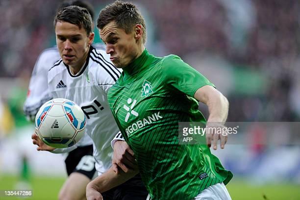 Bremen's striker Markus Rosenberg vies for the ball with Wolfsburg's defender Bjarne Thoelke during the German first division Bundesliga football...