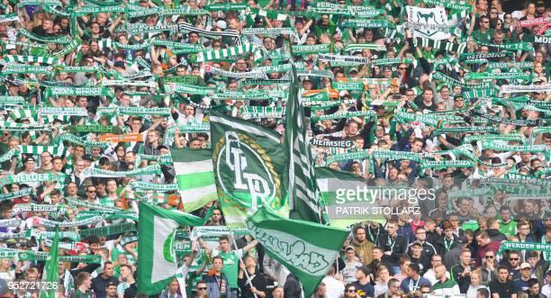 Bremen's supporters cheer up their team before the German first division Bundesliga football match of Werder Bremen versus Borussia Dortmund on April...