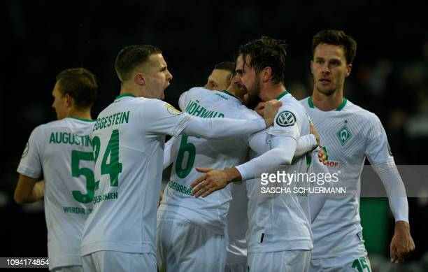 Bremen's Swedish defender Ludwig Augustinsson celebrates scoring the 33 goal with his teammates during the German Cup last 16 football match BVB...