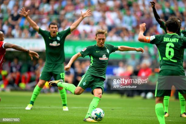 Bremen's Swedish defender Ludwig Augustinsson plays the ball during the German First division Bundesliga football match between Werder Bremen and...