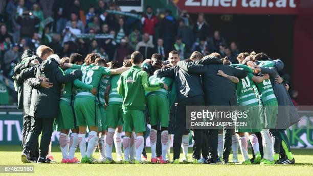 Bremen's team celebrates after the German first division Bundesliga football match between Werder Bremen and Hertha Berlin on April 29, 2017 in...