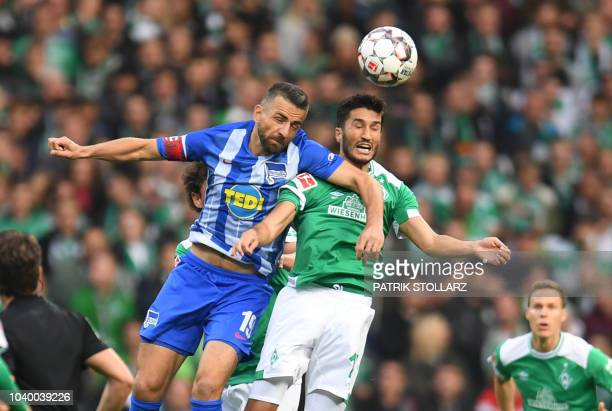 Bremen's Turkish forward Nuri Sahin and Berlin's Bosnian forward Vedad Ibisevic vie for the ball during the German first division Bundesliga football...