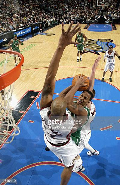 Bremer of the Boston Celtics attempts a shot against Derrick Coleman of the Philadelphia 76ers during the game at First Union Center on January 20,...