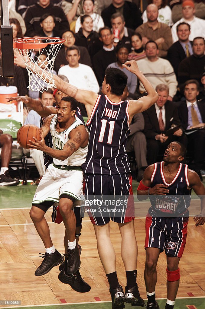 J.R. Bremer #9 of the Boston Celtics goes up for the shot against Yao Ming #11of the Houston Rockets during the NBA game at Fleet Center on February 24, 2003 in Boston, Massachusetts. The Rockets won in overtime 101-95.