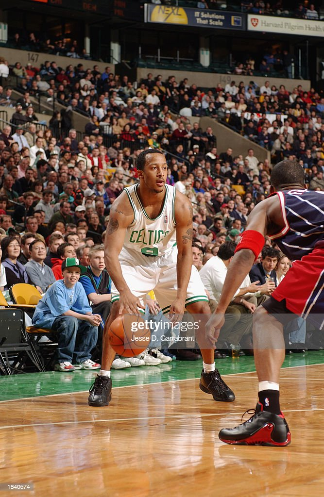J.R. Bremer #9 of the Boston Celtics handles the ball during the NBA game against the Houston Rockets at Fleet Center on February 24, 2003 in Boston, Massachusetts. The Rockets won in overtime 101-95.