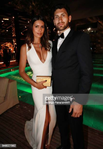 Brena Costa and Karim AlFayed attend the 2018 amfAR gala Sao Paulo at the home of Dinho Diniz on April 13 2018 in Sao Paulo Brazil