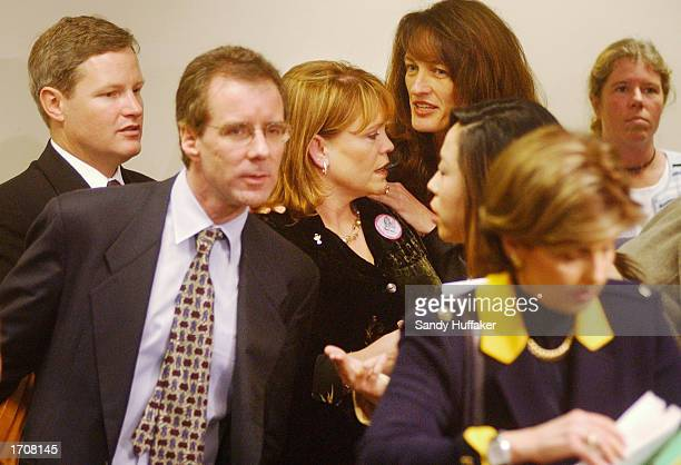 Brenda and Damon van Dam attend a news confernce with their attorneys and friends at the Superior Courthouse January 3 2002 in San Diego California...