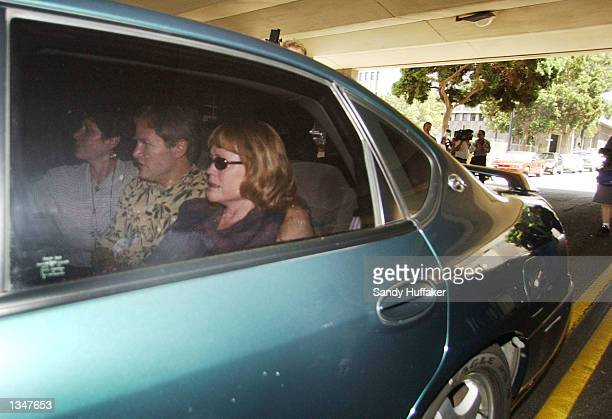 Brenda and Damon van Dam parents of the murdered 7yearold Danielle van Dam and an unidentified person leave the San Diego County Courthouse August 21...