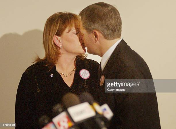 Brenda and Damon van Dam share a moment before giving a news conference at the Superior Courthouse January 3 2002 in San Diego California Convicted...