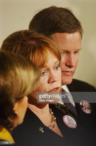 Brenda and Damon van Dam speak to the news media during a news conference at the Superior Courthouse January 3 2002 in San Diego California Convicted...