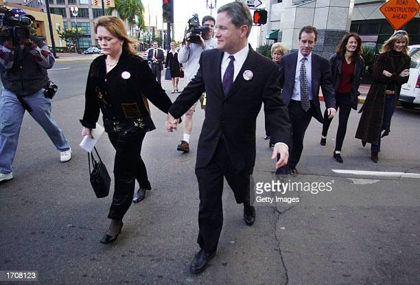 Brenda and Damon van Dam walk towards the Superior Courthouse January 3 2002 in San Diego California Convicted murderer David Westerfield received...