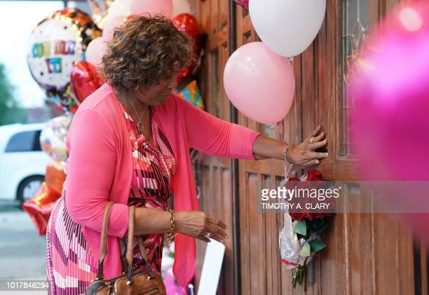Brenda Averett of Detroit places flowers at a temporary memorial set up for late singer Aretha Franklin at New Bethel Baptist Church in Detroit...