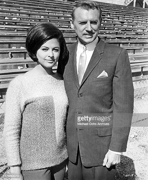 Brenda Benet with Chet Stratton at the racetrack in a scene from the film 'Track of Thunder' 1967