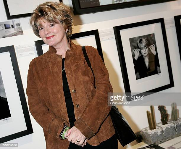Brenda Blethyn poses next to her portrait as she attends the Private View for Andy Gotts Degrees at the Getty Images Gallery on September 29 2005 in...