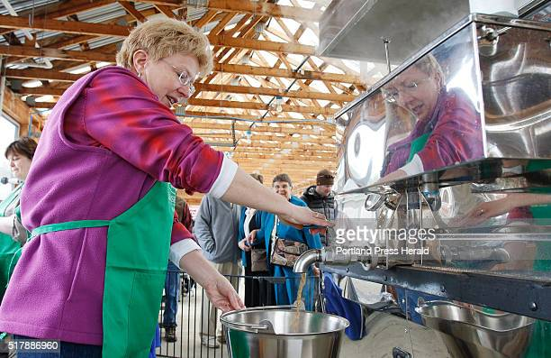 Brenda Boston drains some maple syrup out of the evaporator during Maine Maple Sunday on Sunday March 27 2016 at Chase Farm in Wells Maine
