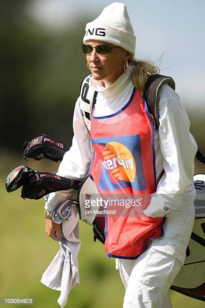 Brenda Calcavecchia caddy to husband Mark Calcavecchia of the USA during the second round of the Senior Open Championship on July 23 2010 at...