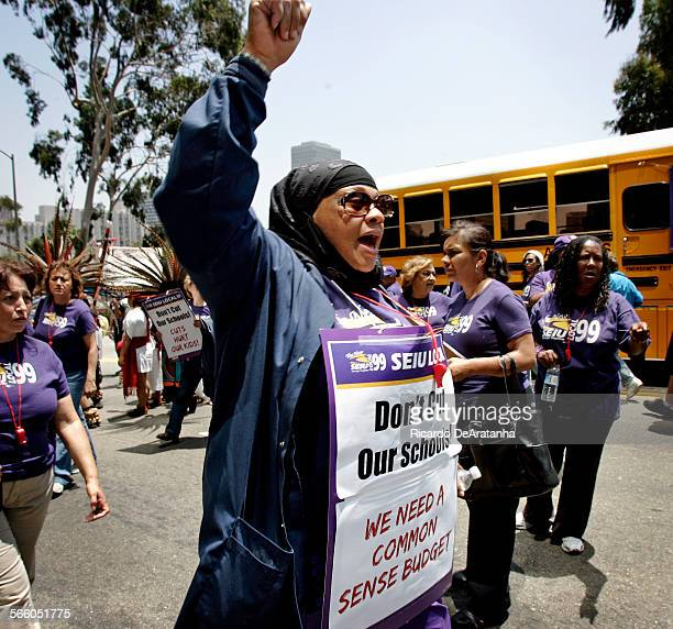 Brenda Carson a cafeteria worker at 52nd Elementary school chanting slogans during a news conference/demonstration outside LAUSD headquarters June 23...