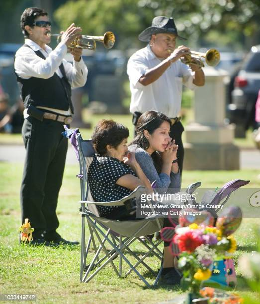 Brenda Contreras at right with her mom Lucia Contreras says she and her family find peace at the graveside of her dad Enrique Contreras Oseguera who...