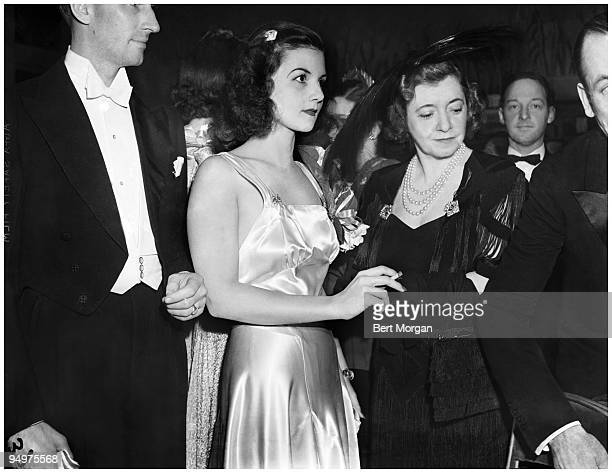 Brenda Frazier the world's most famous debutante and Mrs Fred Watriss at the Metropolitan Opera in New York City November 1938