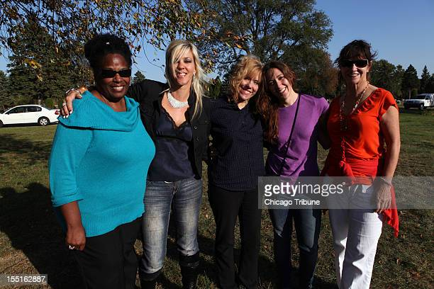 Brenda Fredericks from left Jill Anderson Kristin Schlottman Susan Schlottman and Carol Santos pose for a photo after visiting the gravesite of noted...