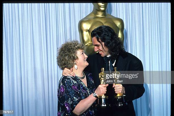 Brenda Fricker and Daniel DayLewis hug backstage during the 62nd Academy Awards ceremony March 26 1990 in Los Angeles CA They received Oscars for...