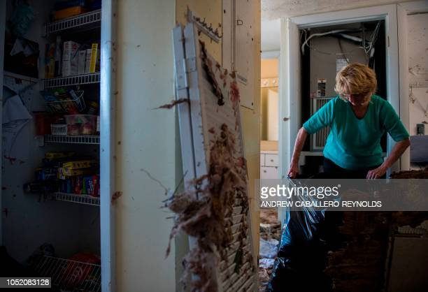Brenda Gerspacher cleans up her damaged beach house in Port St Joe beach Florida on October 13 three days after hurricane Michael hit the area Since...