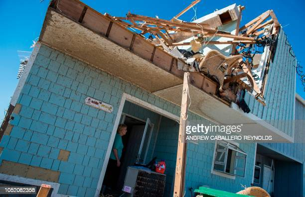 Brenda Gerspacher takes a break as she cleans up her damaged beach house in Port St Joe beach Florida on October 13 three days after hurricane...