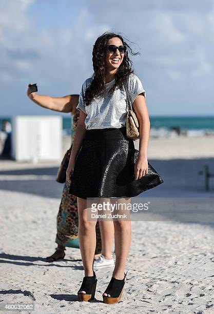 Brenda Gutierrez is seen outside the Scope show wearing a Top shop blouse Bebe skirt Mango shoes and a Chanel bag on December 5 2014 in Miami Beach...