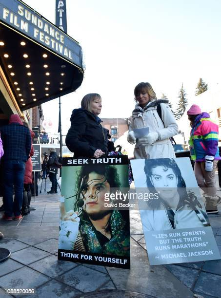 Brenda Jenkyns and Catherine Van Tigem protest the film Leaving Neverland screening at the Egeyptian Theatre at the 2019 Sundance Film Festival on...