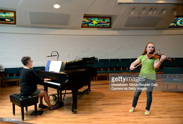 Brenda Kyzer plays the piano for Fiona Patterson during a rehearsal Friday, Aug. 30, 2013 for a Sept. 6th concert at Westview Presbyterian Church,...