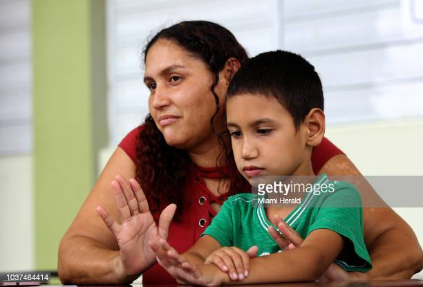 Brenda Lopez feels betrayed as she talks about the closing of her son's school on August 11 in Anasco Puerto Rico Angel Miguel Torres suffers...