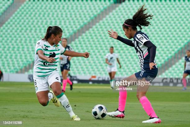 Brenda Lopez of Santos fights for the ball with Diana Garcia of Monterrey during a match between Santos and Monterrey as part of the Torneo Grita...