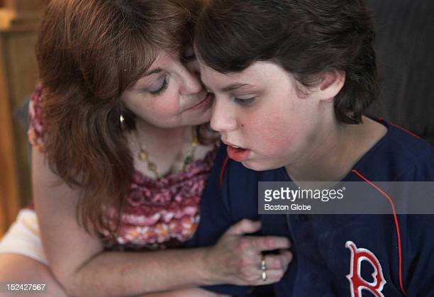 Brenda Manning had a quiet moment with her son Brian who was recovering at home after an eighthour hemispherectomy to stop his epileptic seizures...