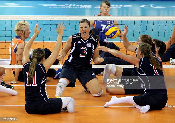 Brenda Maymon of USA celebrates a point during the Sitting Volleyball match between the USA and the Netherlands at China Agricultural Gymnasium...