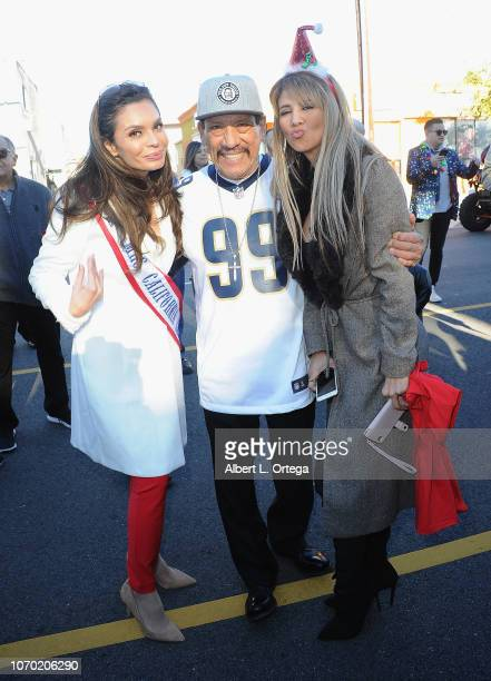 Brenda Mejia Danny Trejo and Leila Ciancaglini attend The 51st Annual Pacoima Holiday Parade on December 8 2018 in Pacoima California