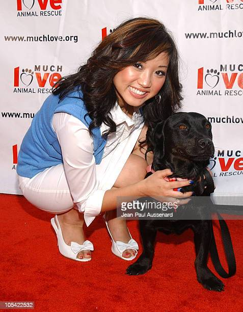 Brenda Song with a dog up for adoption at Much Love Animal Rescue
