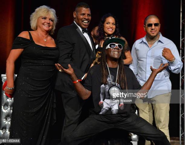 Brenda Spinks wife of former boxer Leon Spinks Rasheda Ali daughter of former boxer Muhammed Ali and rapper Flavor Flav pose for a photo as Spinks is...