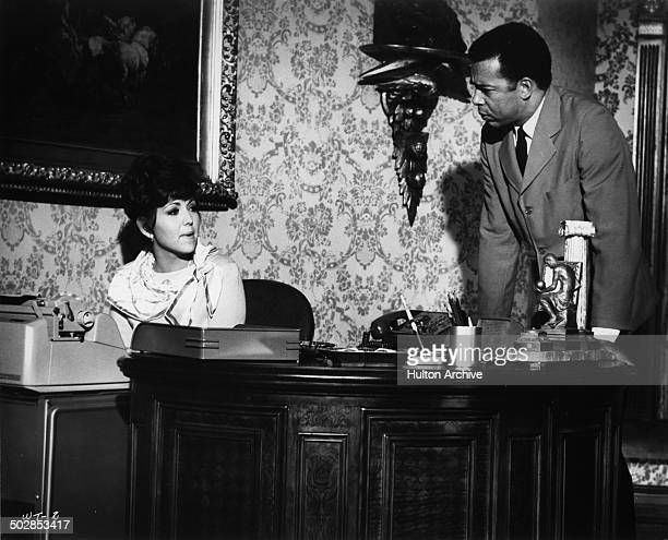 Brenda Vaccaro gives instructions to Vince Howard in a scene for the United Artist movie Where It's At circa 1968