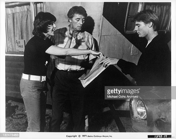 Brenda Vaccaro gives JanMichael Vincent a bag fir him to breathe into to stop his hiccups in a scene from the film 'Going Home' 1971