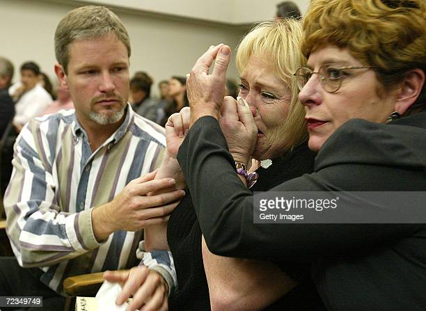 Brenda van Dam breaks down as she is consoled by a friend while her husband Damon listens to court proceedings in the arraignment against David...