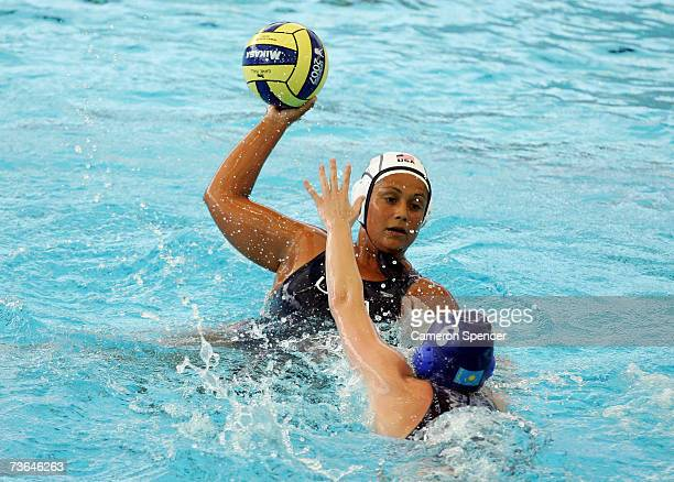 Brenda Villa of the United States looks to pass the ball as Anna Zubkova of Kazakhstan defends in the Women's Preliminary Round Group C Water Polo...